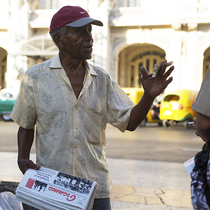 Man in Parque Central reading Granma in Havana
