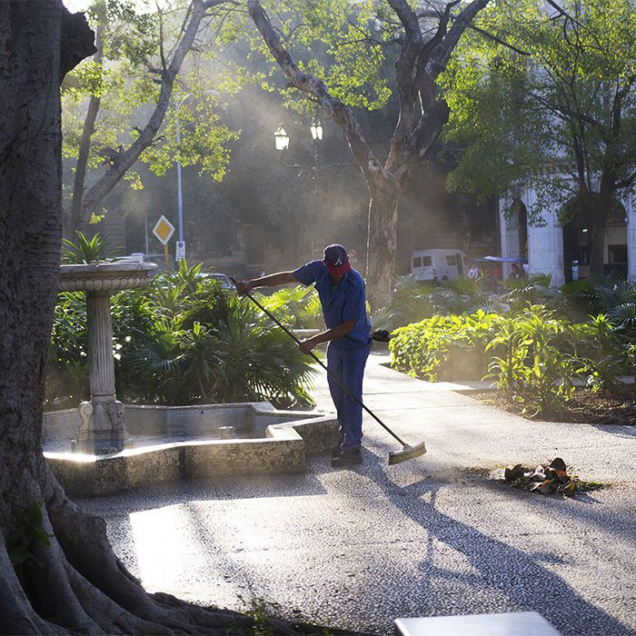 Man sweeping Parque Central in Havana