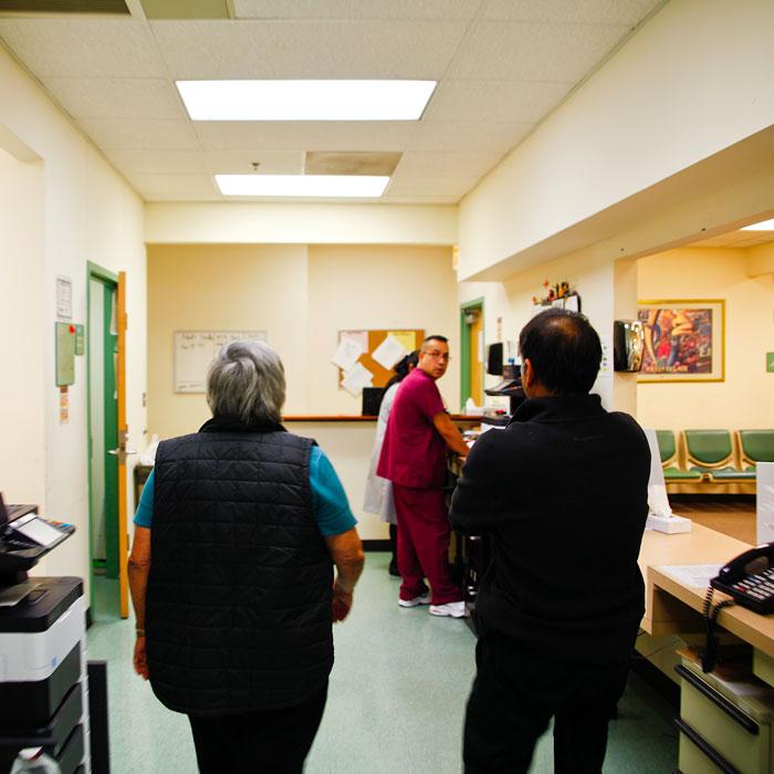 Carmen Velásquez walks through the clinic with Dr. Bhurgri
