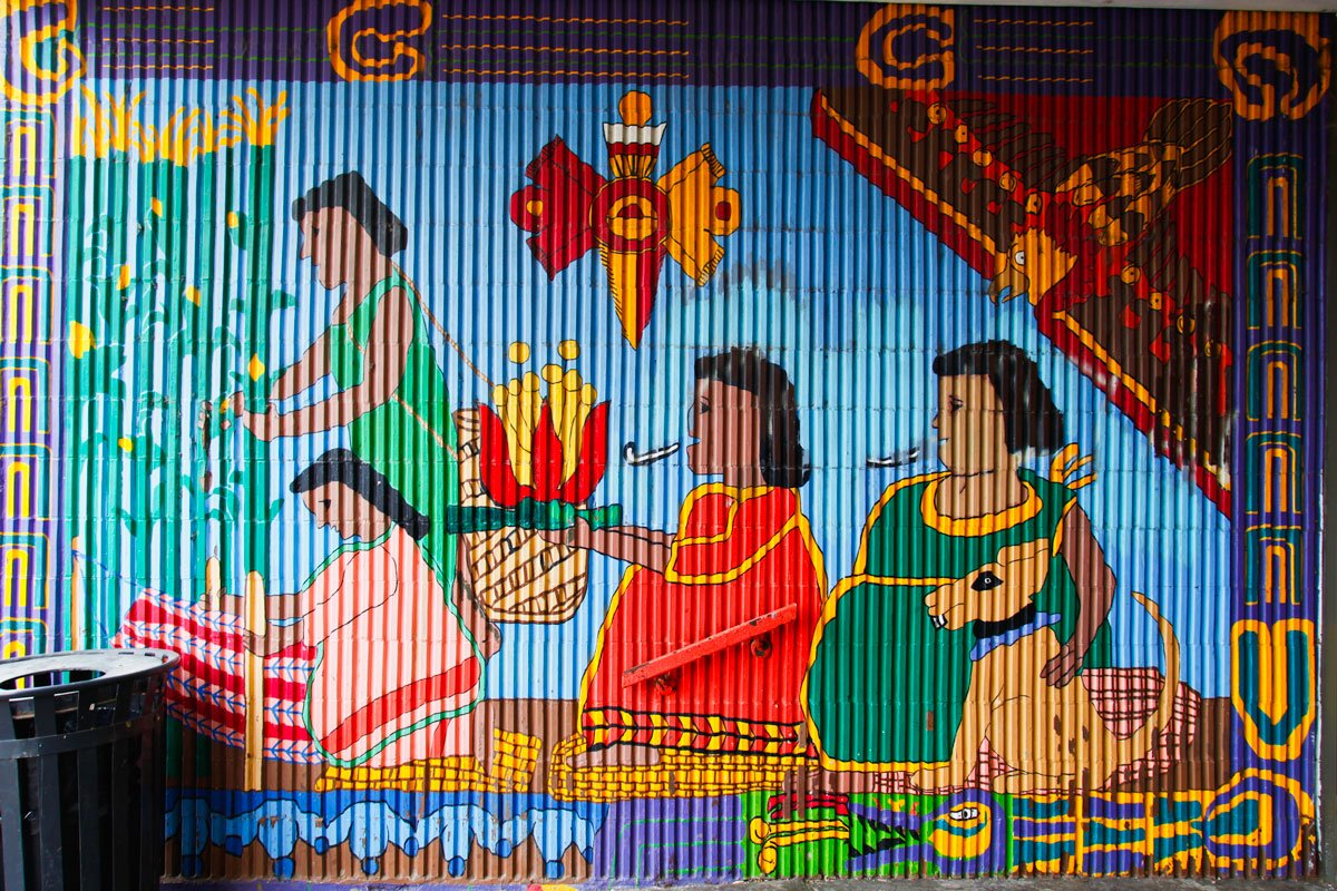 Murals outside the entrance to Benito Juarez High School