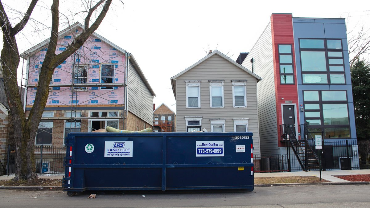 On the same block in Pilsen you can find a renovation, an older home, and a brad new construction happening