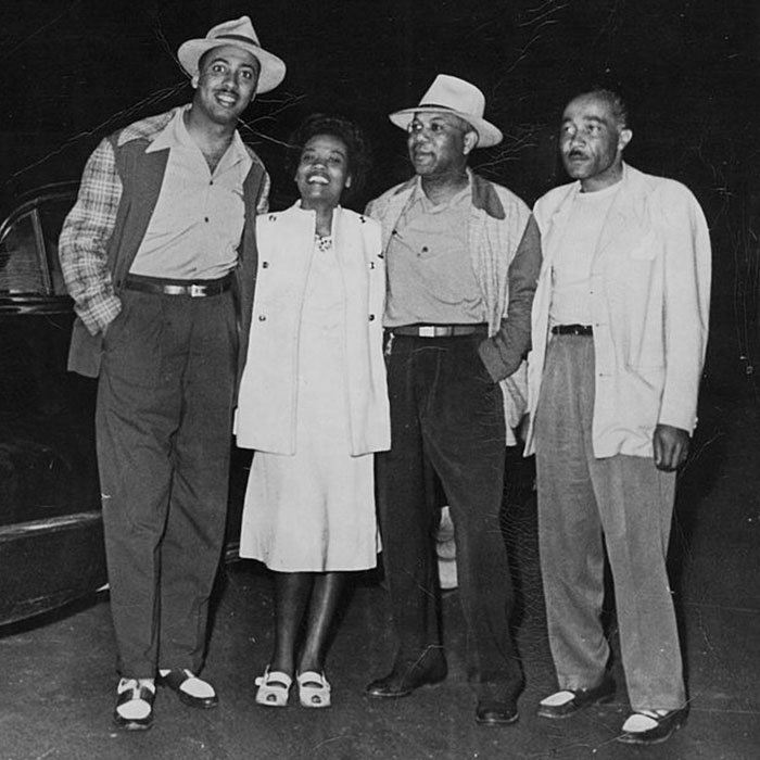 Vacationers dressed up for a night out in Idlewild, circa 1947