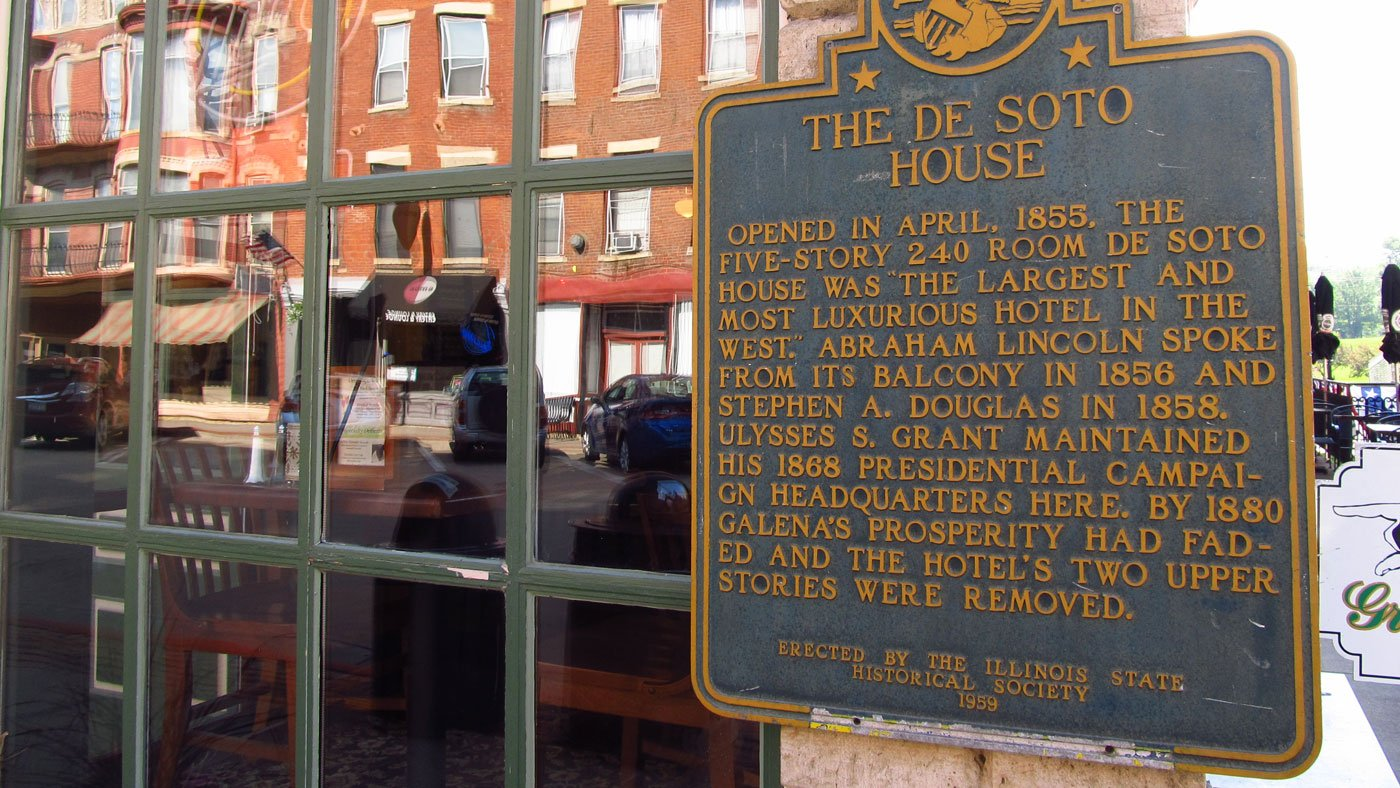 A plaque on the exterior of the De Soto House details the building's long history in Galena, Illinois