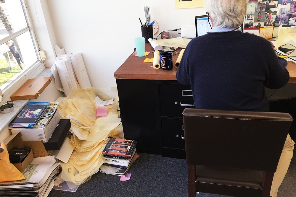 Scott Merrill at his desk