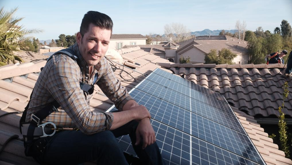 Jonathan Scott on roof with solar panels