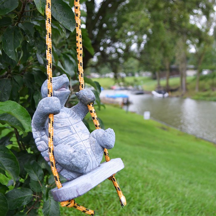 turtle sculpture hangs from a tree near Indian Lake in Silver Creek, Michigan