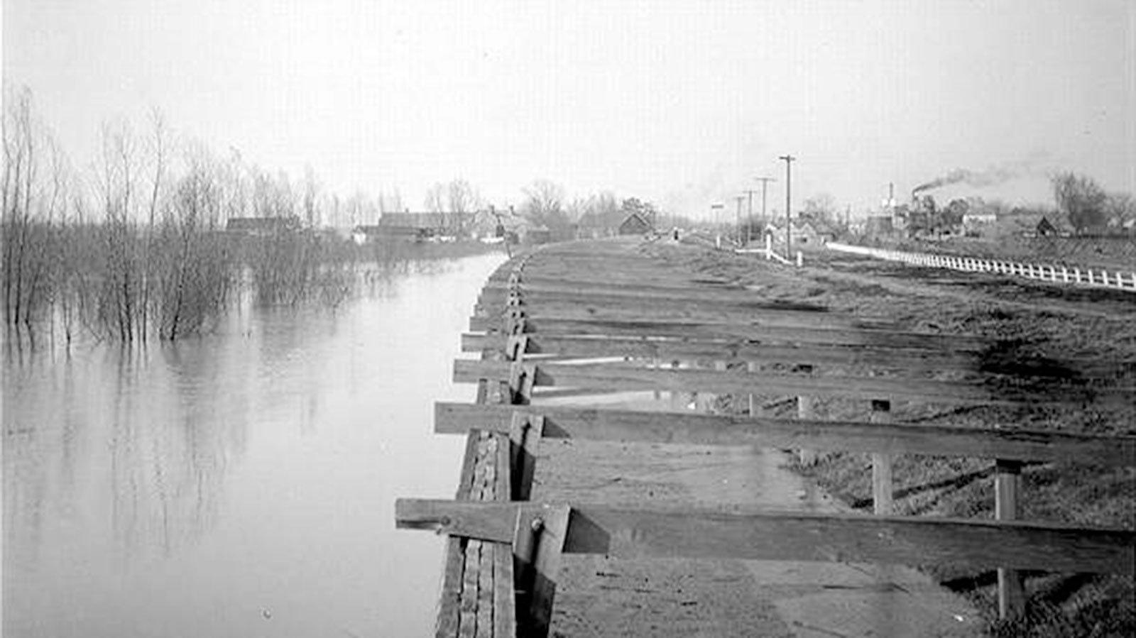 A high river and board revetment at Carrollton Bend in New Orleans, Louisiana, circa 1900