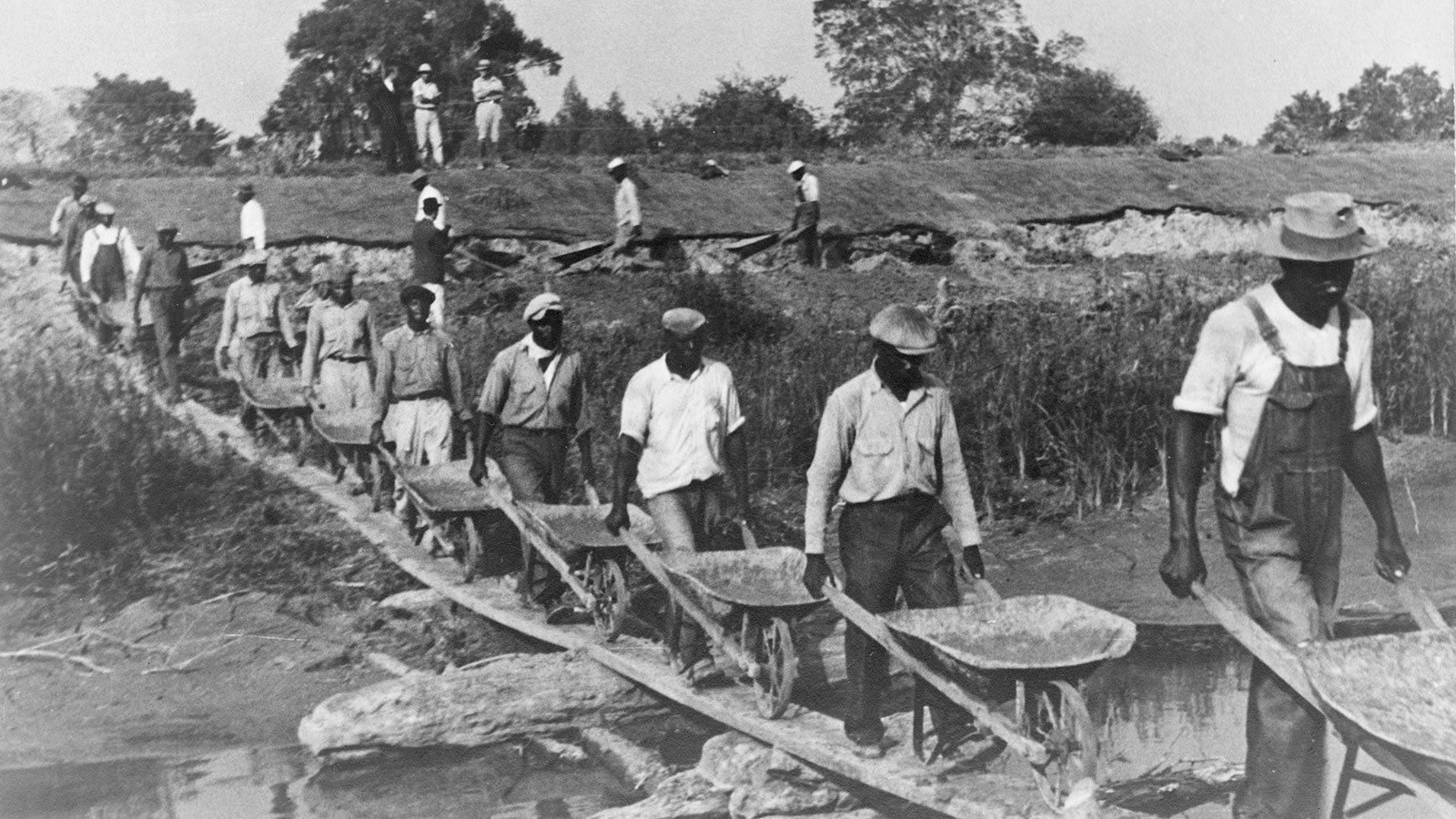 Workers build a levee in Plaquemine Parish, just south of New Orleans, Louisiana, in 1935