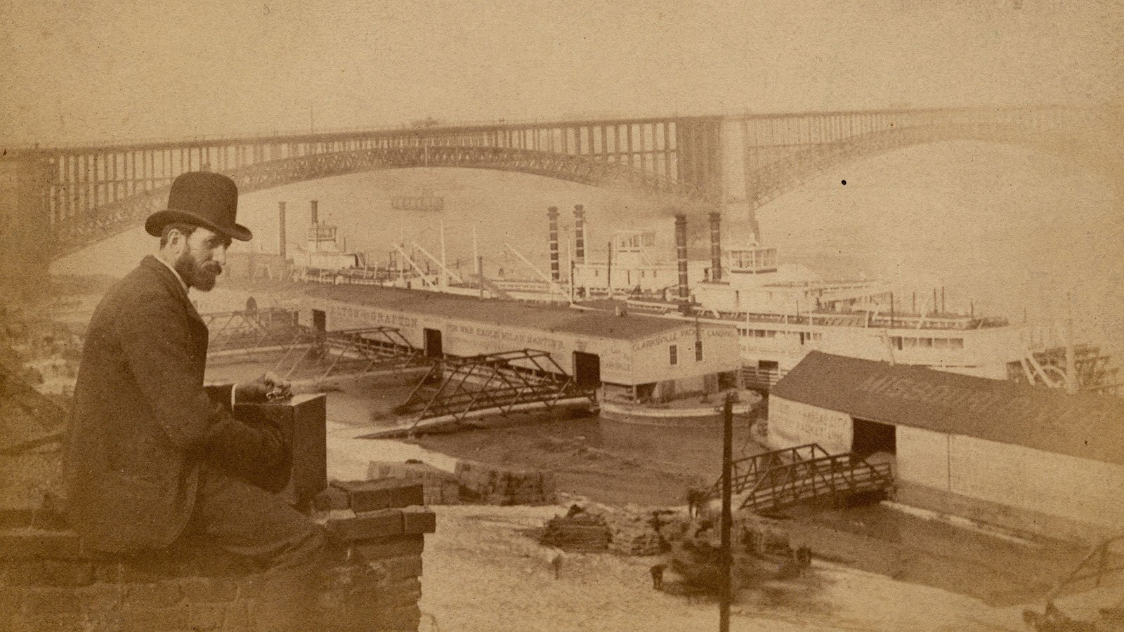 River traffic at the Eads Bridge, with Professor William Butler in the foreground