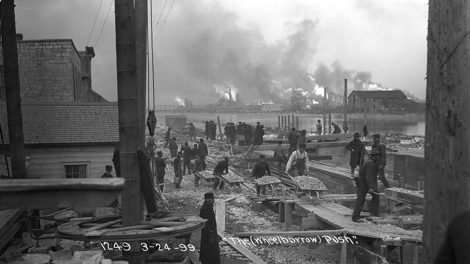 Workers move gravel during lock construction along the Chicago Sanitary and Ship Canal in Joliet, Illinois, on March 24, 1899