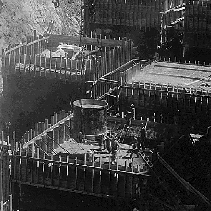 Placing concrete in panel or column forms near downstream toe in Boulder Dam foundation
