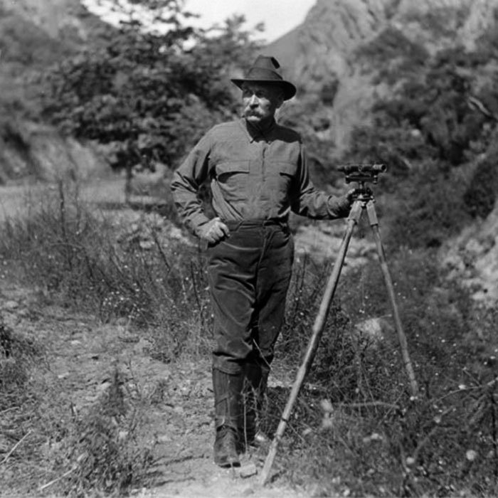 William Mulholland in the field with his surveying instrument