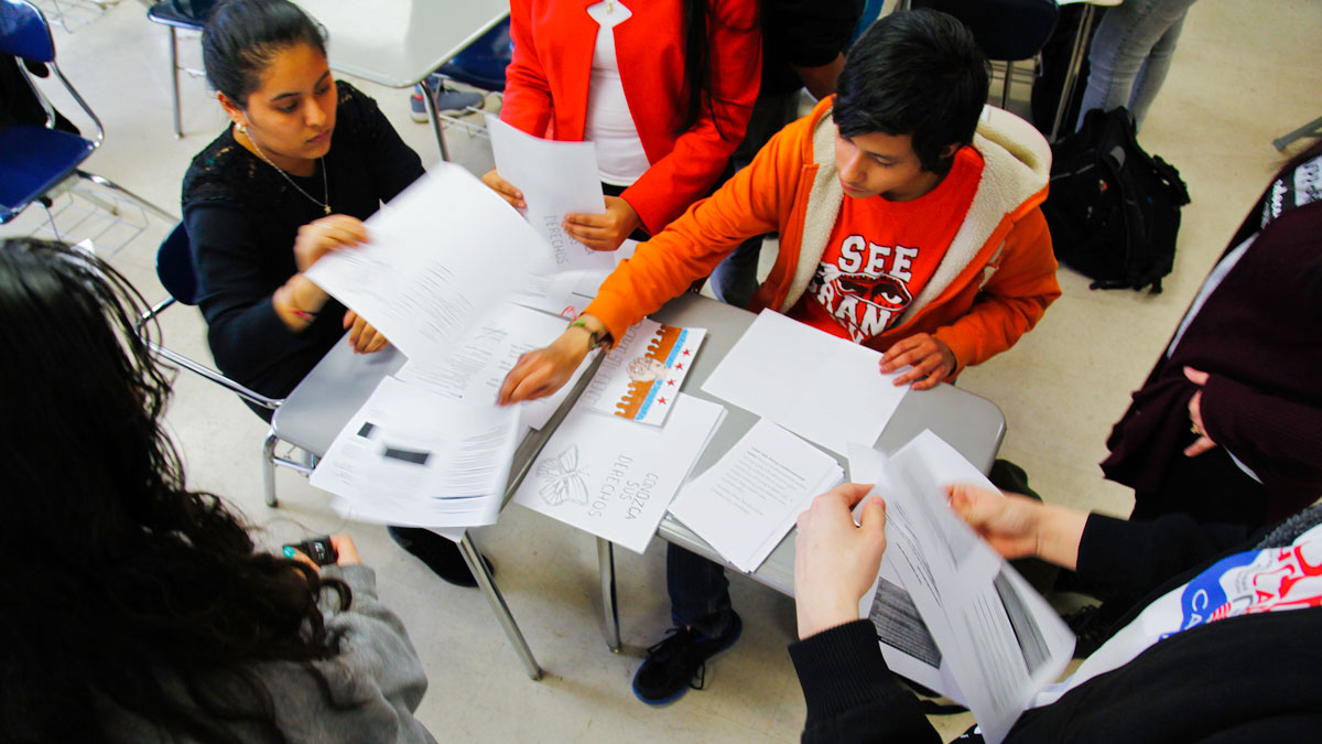 Student groups Monarcas and BuildOn create Know Your Rights pamphlets to pass out
