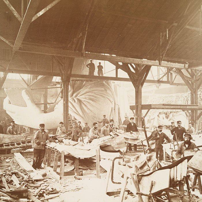 Men in Bartholdi's workshop in Paris, hammering sheets of copper for the construction of the Statue of Liberty, 1883