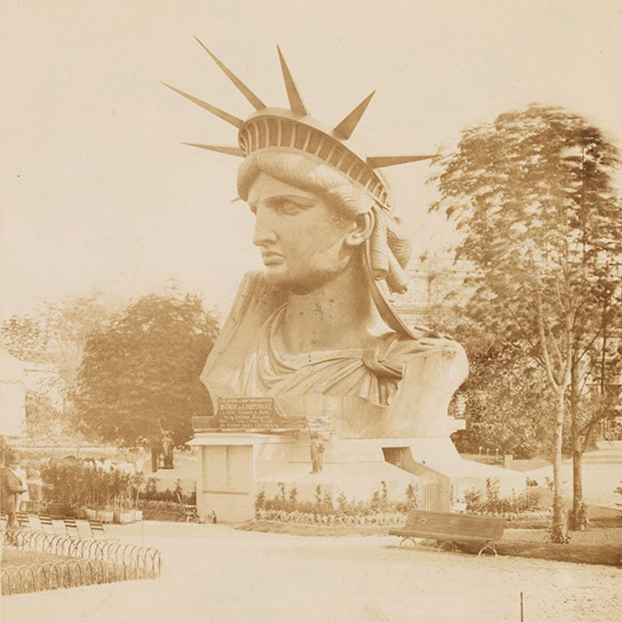 The head of the Statue of Liberty on display in a park in Paris. Photo by Albert Fernique, 1883