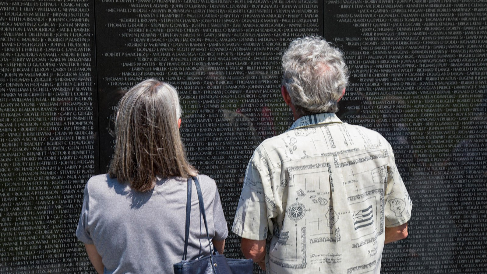 Visitors read the names of the dead or missing at the Vietnam Veterans Memorial in Washington, D.C.