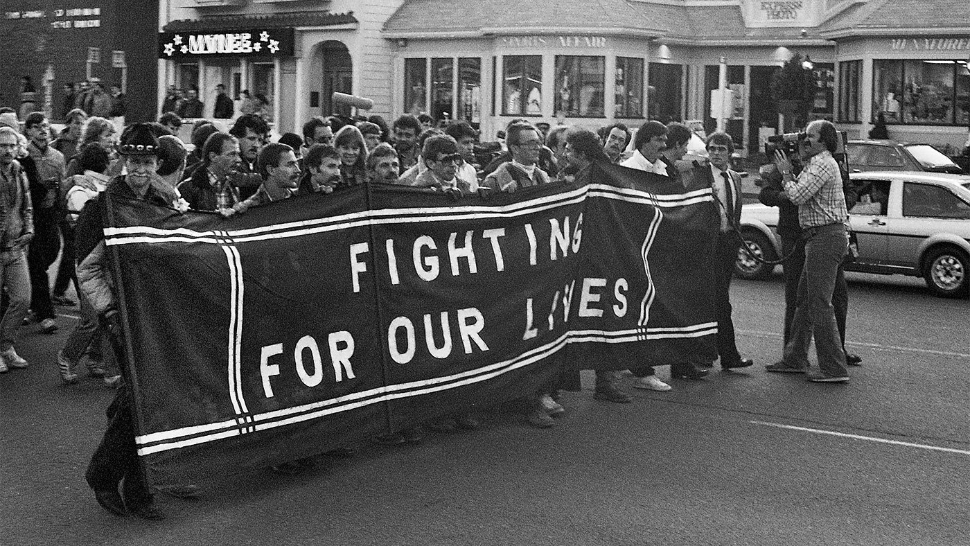 AIDS march with 'Fighting for Our Lives' banner