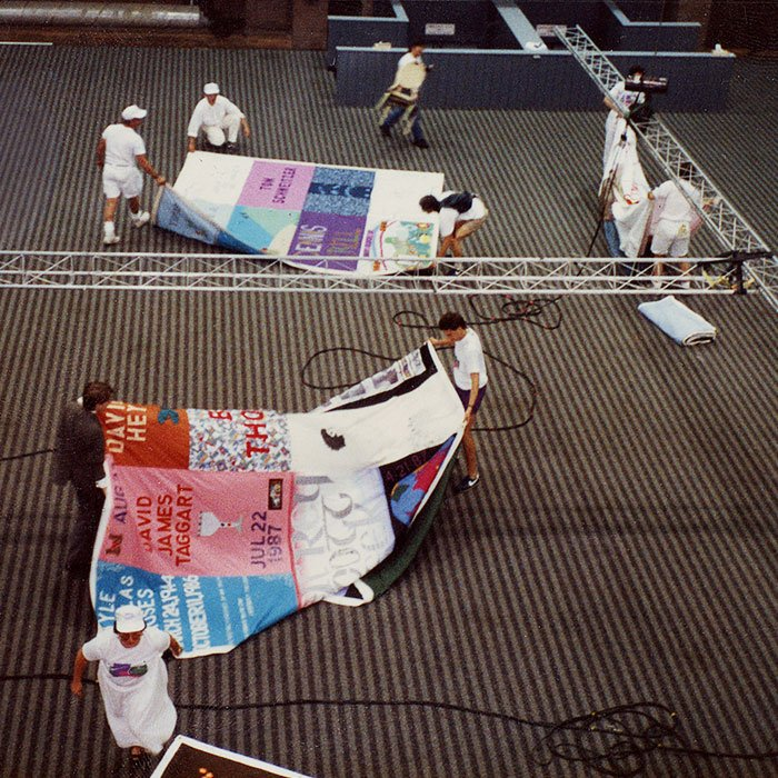 Volunteers unfurl the AIDS Memorial Quilt at an event in Boston, Massachusetts