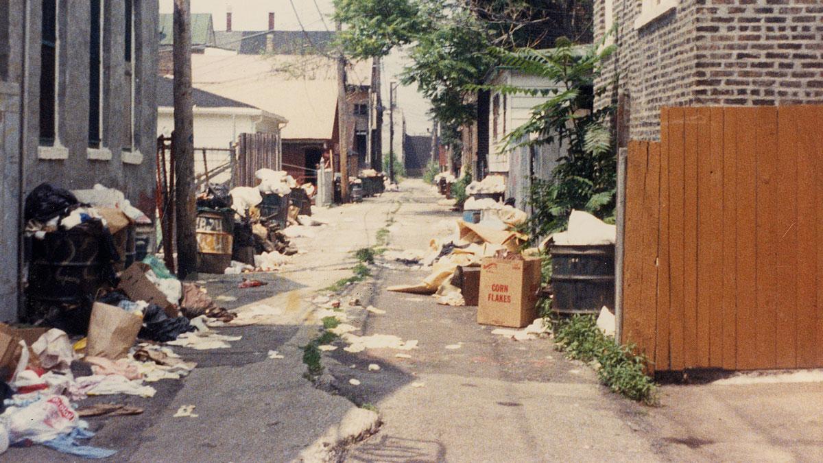 Garbage piled in the alleyways.