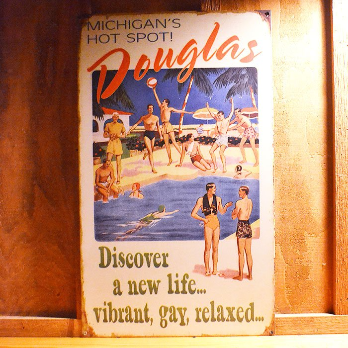 Vintage sign that says 'Discover a new life...vibrant, gay, relaxed'