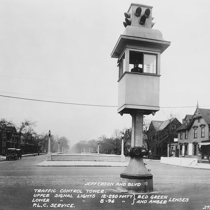 Policeman operating an early traffic light from a control tower at an intersection in Detroit, Michigan, circa 1922