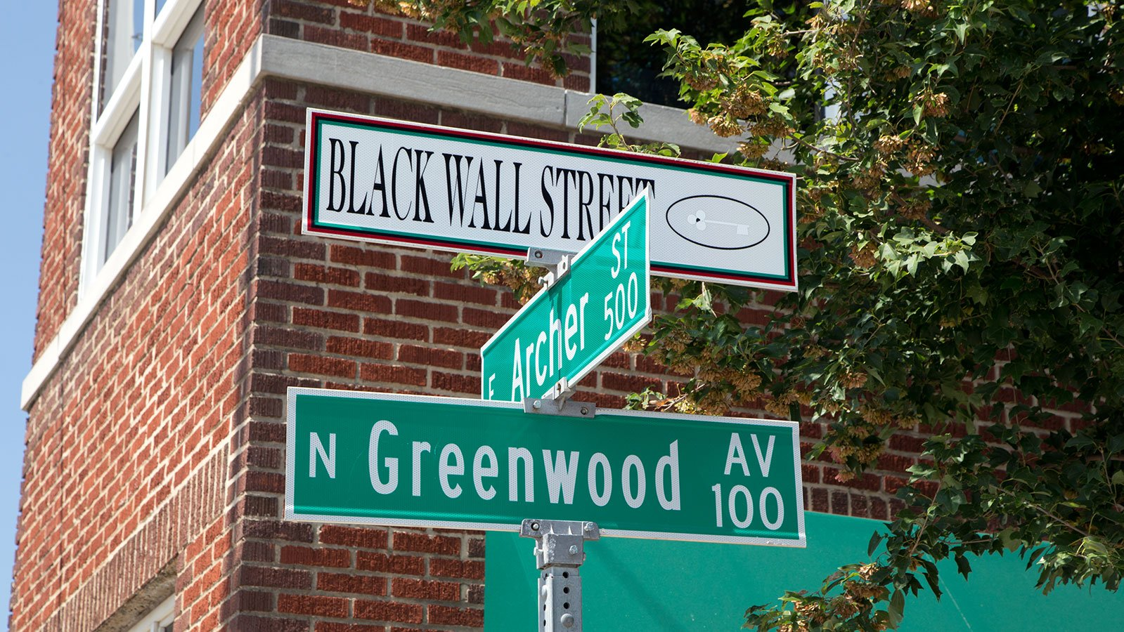 Street signs along Greenwood that commemorate Black Wall Street