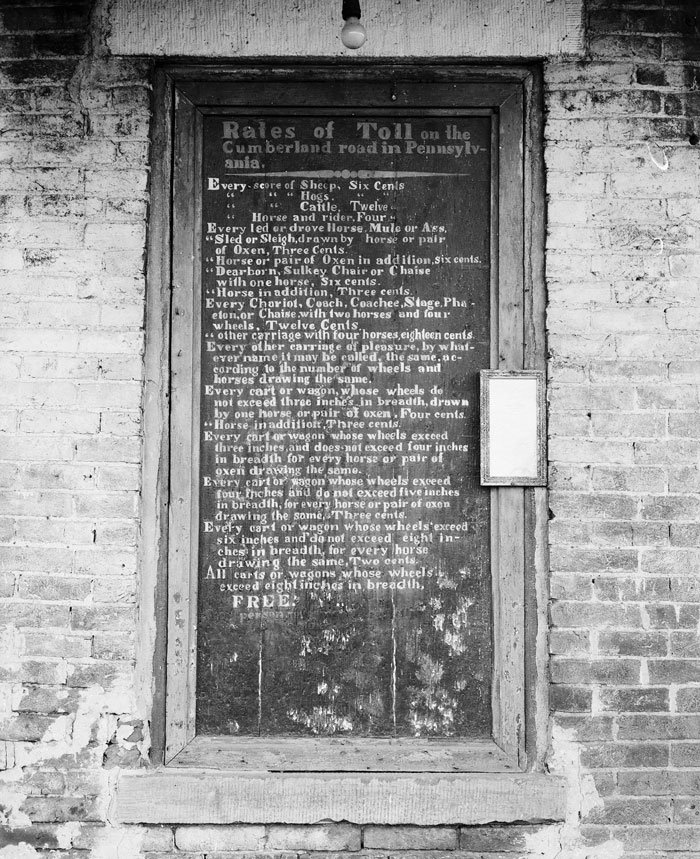 plaque on a toll house along the Old National Trail