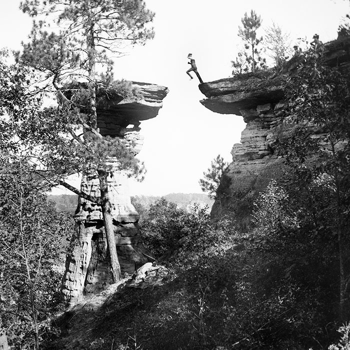 Henry Hamilton Bennett's son, Ashley, leaping across Stand Rock in Wisconsin Dells, Wisconsin in 1886