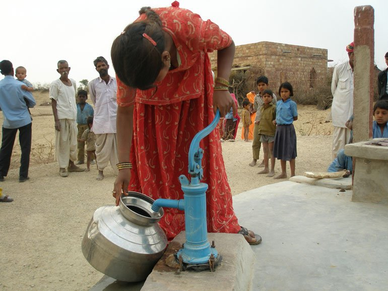 Girl at well in Rajasthan