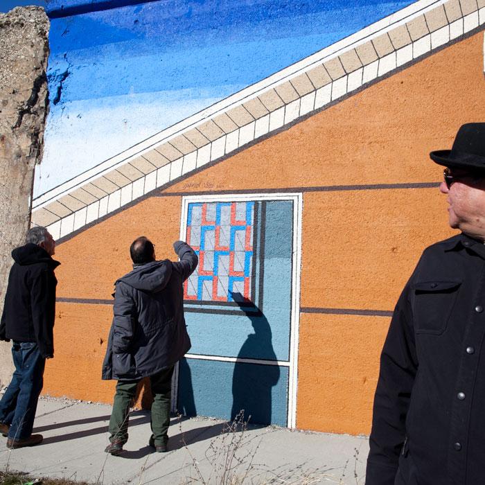 Hector Duarte, Gabriel Villa, and Jeff Maldonado inspect American Paintings