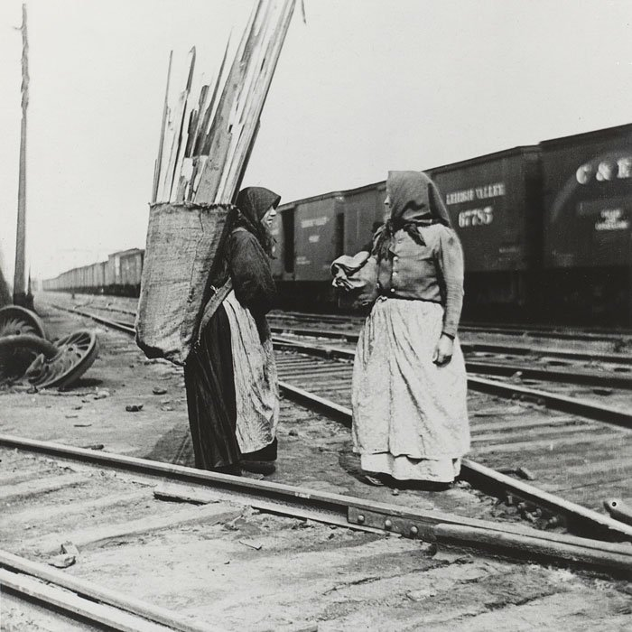 Women collect scrap wood from the Yards.