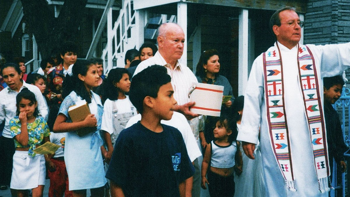 Father Charles Dahm blessing Pilsen's streets during mass.