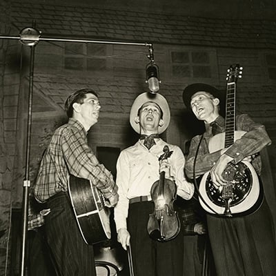 Roy Acuff (center) on the Grand Ole Opry, c.1940 Photo: Courtesy of Grand Ole Opry Archives