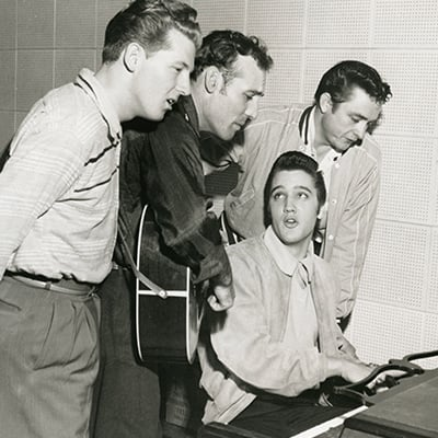 Jerry Lee Lewis, Carl Perkins, Elvis Presley,and Johnny Cash at the Sun Records studio in Memphis, 1956. Photo: Courtesy of Sam Phillips Family/Colin Escott