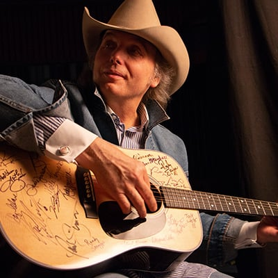 Dwight Yoakam signs a Martin D-28 guitar. Photo: Courtesy of Jared Ames
