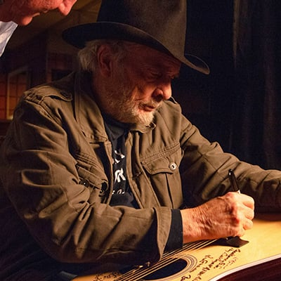 Merle Haggard signs a Martin D-28 guitar. Photo: Courtesy of Jared Ames