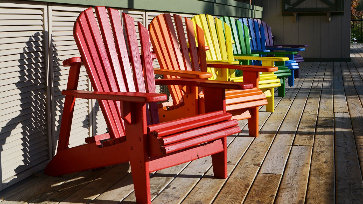Colorful Adirondack chairs at the Dunes Resort