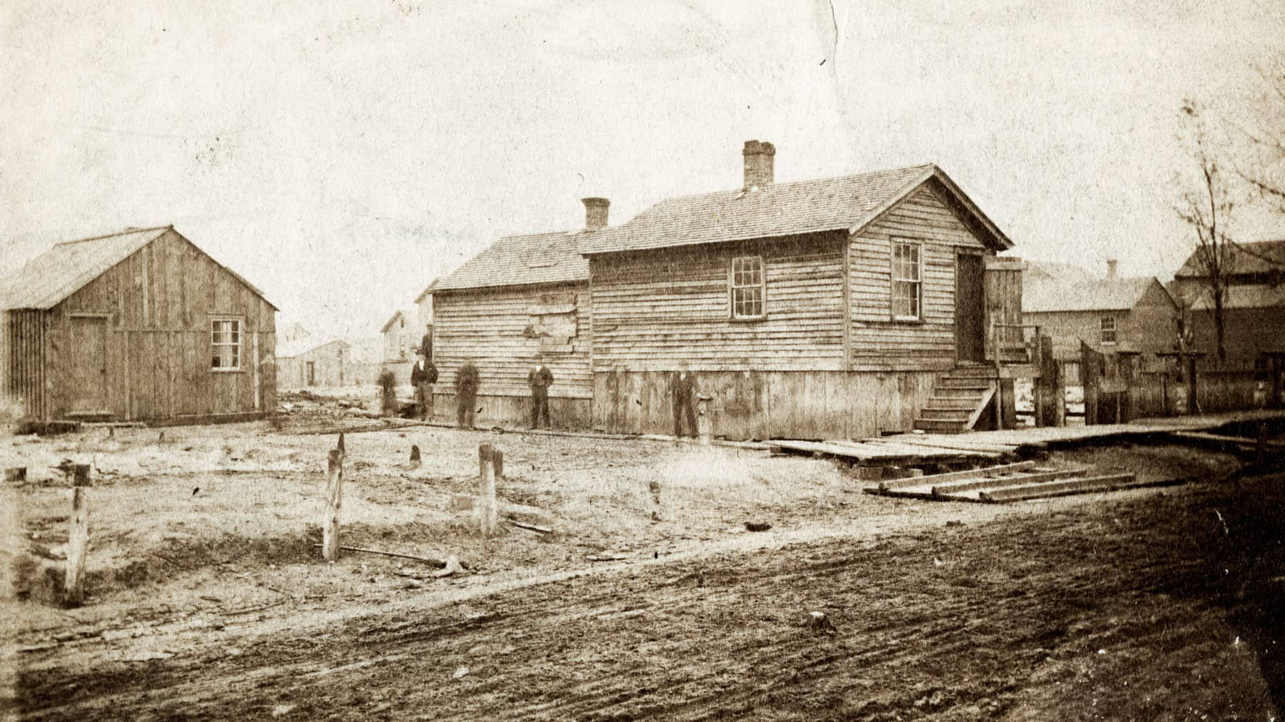O'Leary family cottage and barn with few people standing outside