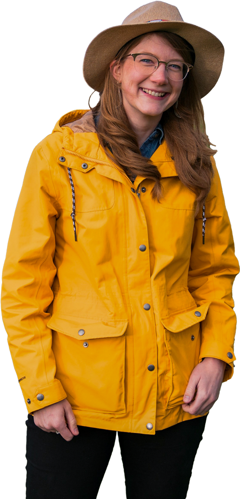 Emilie Graslie wearing raincoat and hat