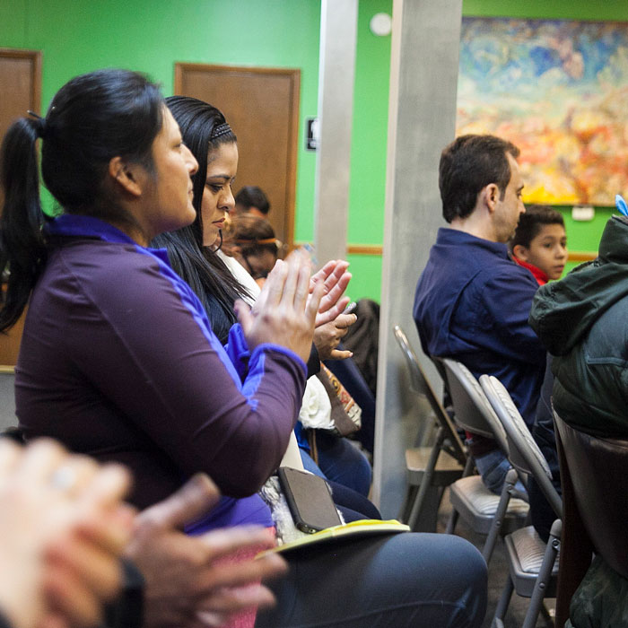 Participants clap after the ESDC presentation for undocumented business owners, parents, and homeowners.