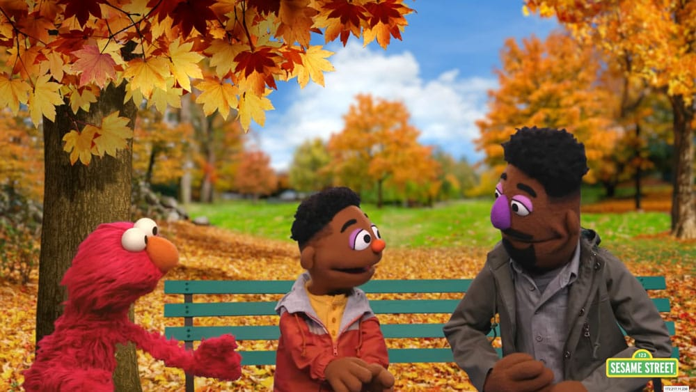 Elmo talking with Wes and Elijah in park