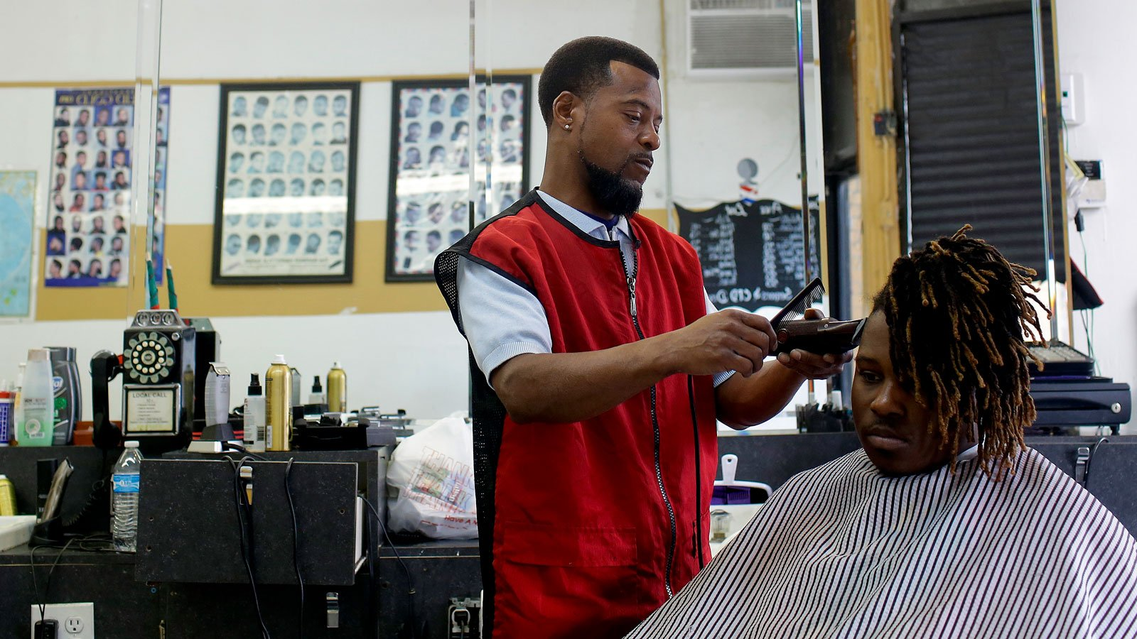 Man getting haircut at barbershop