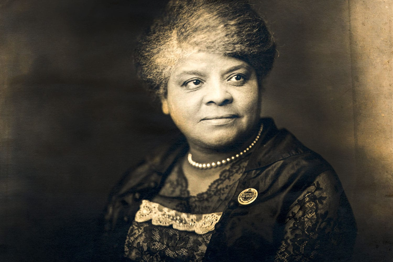 Ida B. Wells portrait wearing a button in support of Black soldiers who were hanged for alleged mutiny