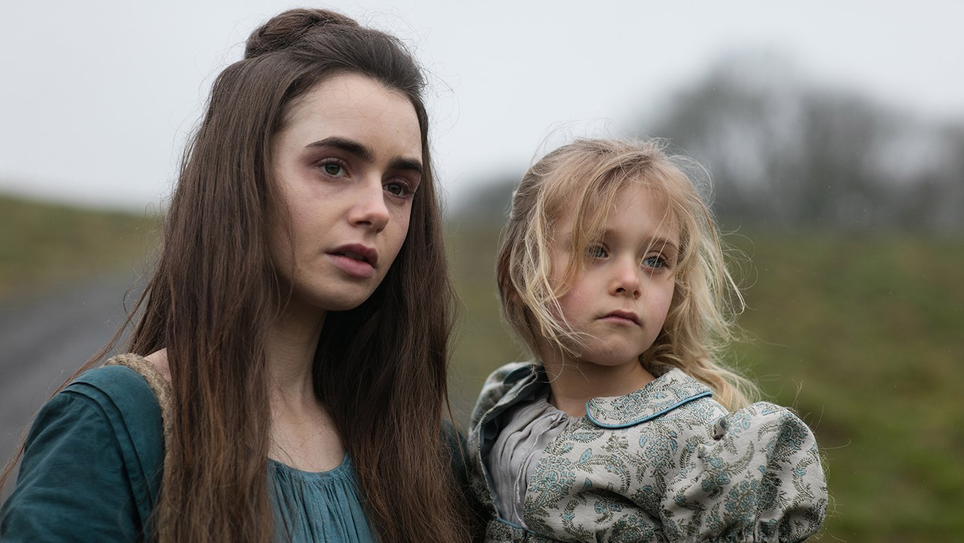 Fantine (Lily Collins) and Cosette (Mailow Defoy) in Les Miserables. Photo: Robert Viglasky / Lookout Point