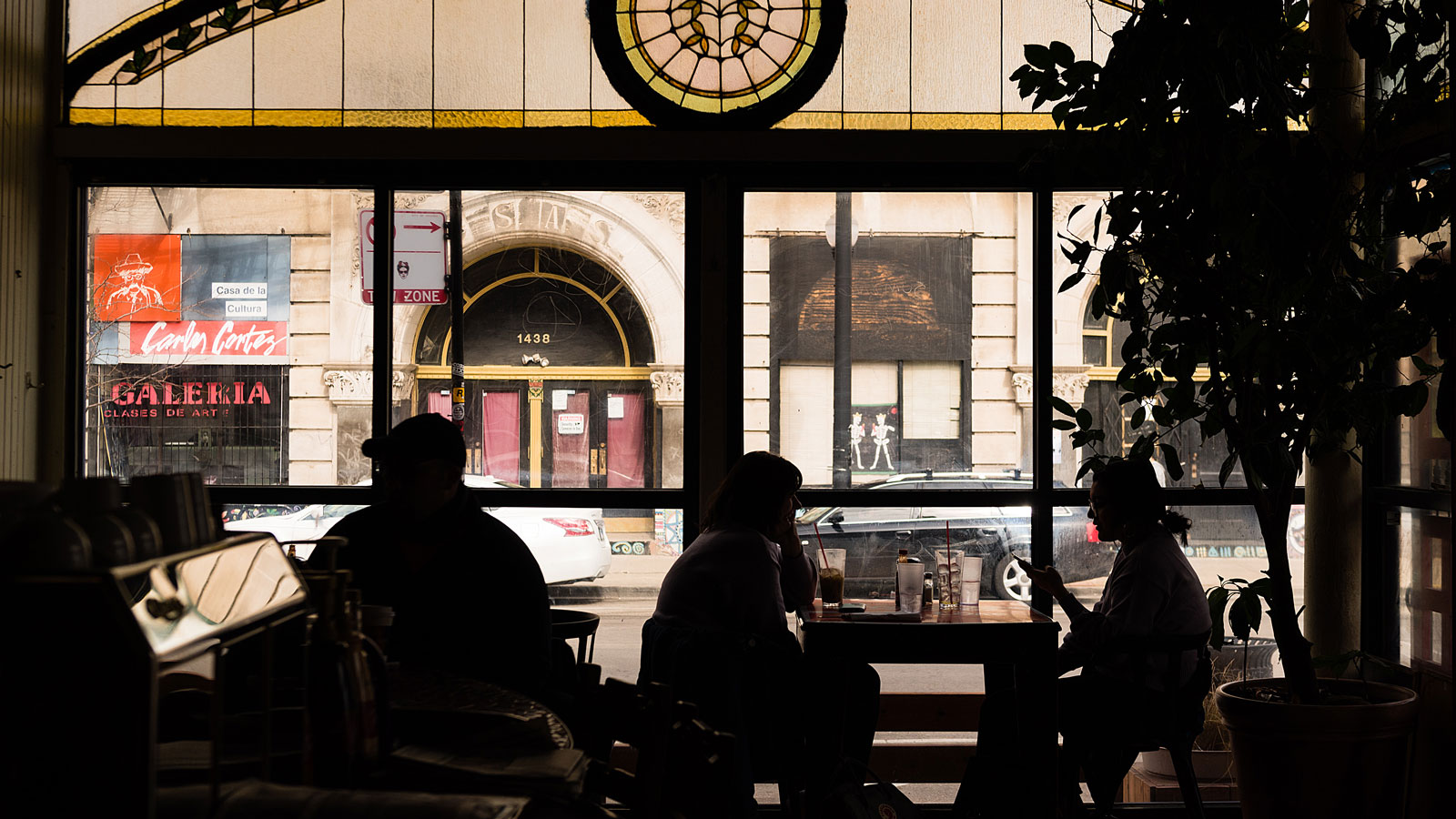Patrons enjoy food and drinks at Café Jumping Bean, a thriving small business in Pilsen