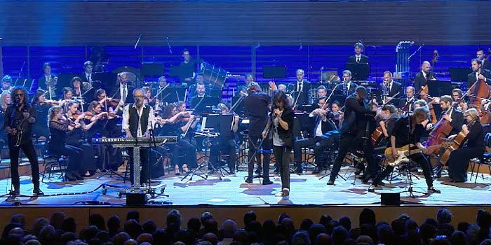 Foreigner bandmembers performing with a symphony