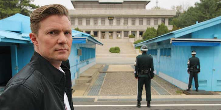 Host Johan Norberg stands in front of the Korean DMZ