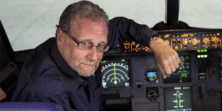 Host Peter Greenberg in the cockpit of an airplane