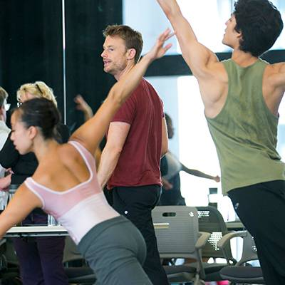 Artistic Director Ashley Wheater and choreographer Christopher Wheeldon (background) and Anastacia Holden¬ and Joan Sebastian Zamora (foreground) in rehearsal (Photo by Todd Rosenberg)