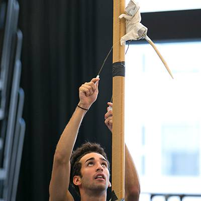 Edson Barbosa rehearsing with a mock-up rat puppet (Photo by Todd Rosenberg)